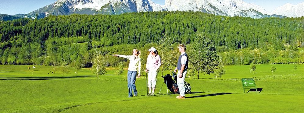 3 Golfer auf grüner Wiese